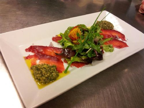 Salmon marinated in beetroot with salsa verde and