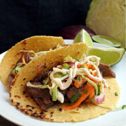 Korean Bulgogi Tacos with Kimchi Slaw and Sriracha