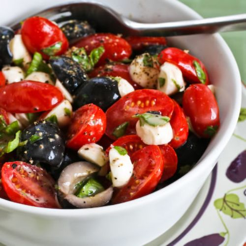 Fresh mozzarella, basil, tomato and olive salad